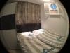 Schlafzimmer mit Bullaugenfenster